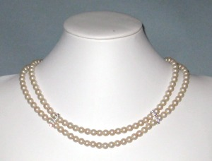 Two-strang cream pearl neckalce by Catherine Chant