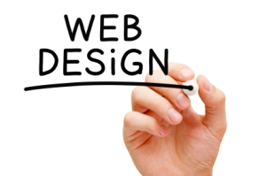 "A hand writing ""Web Design"" on a clear wall"