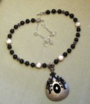 Handmade Black and White Beaded Necklace with Silver Teardrop pendant
