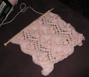 Angel Blossom knitted block in progress on needle