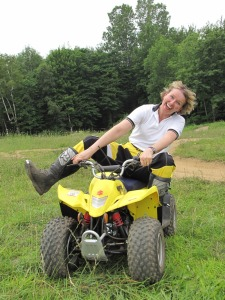Author Charlotte Cooper having fun on an ATV