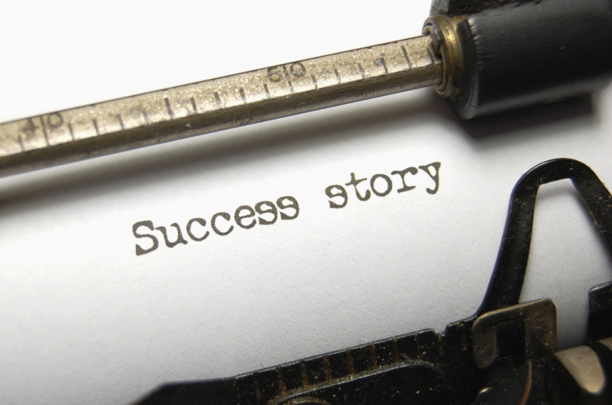 Piece of paper in a typewriter that says Success Story
